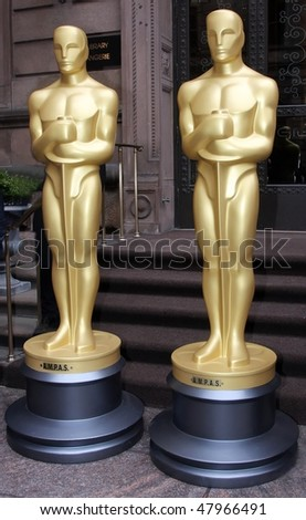 NEW YORK - MARCH 4: Two 8-foot golden statues arrive at GILT at the New York Palace Hotel as part of the official New York Oscar night celebration on March 4, 2010 in New York City - stock photo