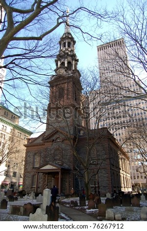 NEW YORK - MARCH 5: Visitors to St. Paul's Chapel walk near its entrance on March 5, 2006 in New York City. The chapel and the surrounding burial ground are part of Trinity Church which is located across from the World Trade Center in lower Manhattan. - stock photo