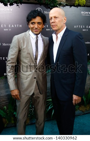 """NEW YORK - MAY 29: Actor Bruce Willis (R) and M. Night Shyamalan attend the premiere of """"After Earth"""" at the Ziegfeld Theatre on May 29, 2013 in New York City.  - stock photo"""