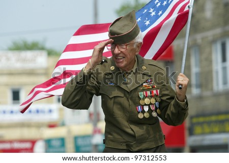 NEW YORK - MAY 29:  An unidentified veteran salutes as he marches in the Little Neck/Douglaston Memorial Day Parade May 29, 2006 in Queens, NY. - stock photo