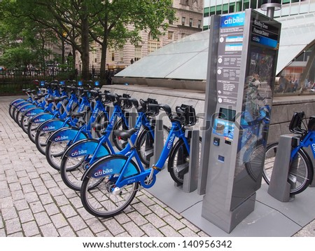 NEW YORK - MAY 28: Bicycles for the Citibike bike share system lie docked in a rack near Bowling Green, Manhattan, May 28, 2013 in New York City. The bicycle-sharing program began operation May 2013. - stock photo