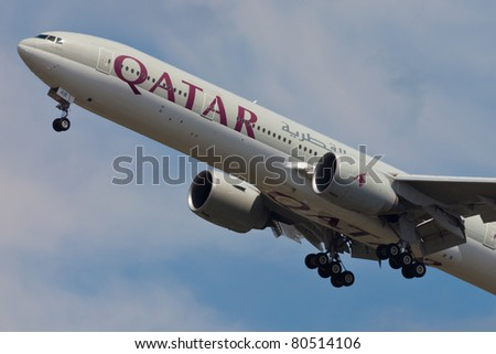 NEW YORK - MAY 5: Boeing 777 Qatar on final approach to JFK in New York, USA on May 5, 2010. Qatar Airline is rated as top3 best airlines in the world. Qatar airline is flag carrier airline of Qatar - stock photo