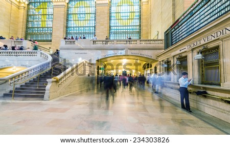 NEW YORK, MAY 14: Commuters and tourists in the grand central station in May 14, 2013 in New York. It is the largest train station in the world by number of platforms: 44, with 67 tracks. - stock photo