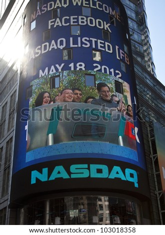 NEW YORK - MAY 18: Facebook CEO Mark Zukerberg is flashed on a screen outside the NASDAQ stock exchange at the opening bell in Times Square on May 18, 2012 in New York City.