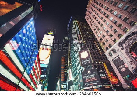 NEW YORK - MAY 12: Featured with Broadway Theaters, American flag on screen and animated LED signs, is a symbol of New York City and the United States, May 12, 2015 in Manhattan, New York City - stock photo