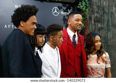 """NEW YORK - MAY 29: (L to R): Trey Smith, Will Smith and Jada Pinkett Smith attend the premiere of """"After Earth"""" at the Ziegfeld Theatre on May 29, 2013 in New York City.  - stock photo"""