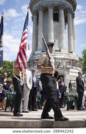 NEW YORK - MAY 25 2015: Members of the Navy JROTC Color Guard step off the stone stairs of the Soldiers and Sailors Monument concluding the Memorial Day Observance service during Fleet Week NY 2015. - stock photo