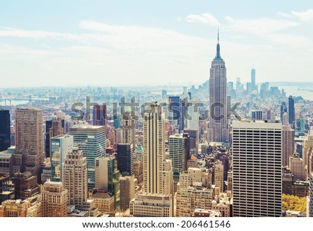 NEW YORK - MAY 3, 2014: New York City Manhattan midtown aerial panorama view with skyscrapers and blue sky in the day. Empire State Building view. - stock photo