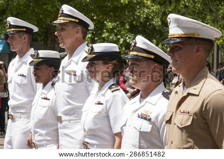 NEW YORK - MAY 22 2015: Participating US Navy and Marine Corps personnel stand at attention at the promotion ceremony at the National September 11 Memorial site during Fleet Week 2015. - stock photo