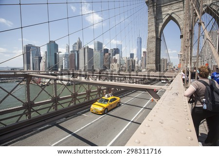 NEW YORK - May 30, 2015: People ejoying a walk along Brooklyn Bridge in New York city. - stock photo