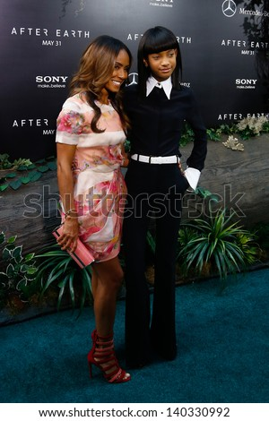 """NEW YORK - MAY 29: Producer Jada Pinkett Smith and Willow Smith attend the premiere of """"After Earth"""" at the Ziegfeld Theatre on May 29, 2013 in New York City.  - stock photo"""