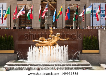 NEW YORK - MAY 7: Prometheus monument and flags on May 7, 2013, in Rockefeller Center�´s facade, New York City. - stock photo