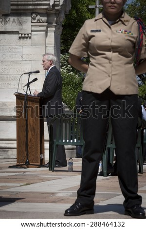 NEW YORK - MAY 25 2015: Secretary of the Navy (SECNAV) Ray Mabus at the podium with a JROTC cadet in foreground during the Memorial Day service at the Soldiers and Sailors Monument in Manahttan. - stock photo