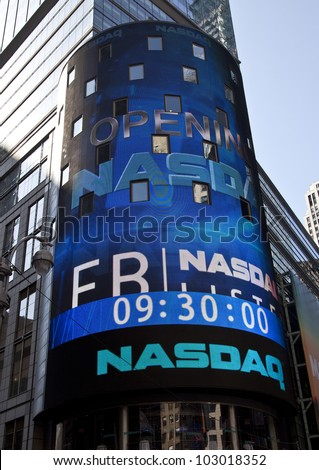 NEW YORK - MAY 18: Sign announcing opening Facebook IPO is flashed on a screen outside the NASDAQ stock exchange at the opening bell in Times Square on May 18, 2012 in New York City. - stock photo