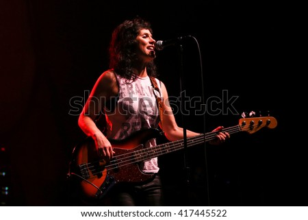 NEW YORK-MAY 6: Singer Kristen Henderson of Antigone Rising performs onstage at the Paramount on May 6, 2016 in Huntington, New York. - stock photo
