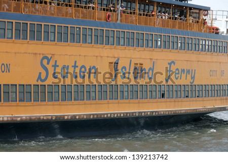 NEW YORK - MAY 17: The Staten Island Ferry John F. Kennedy is shown on May 17, 2013 in New York. - stock photo