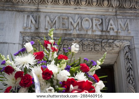 NEW YORK - MAY 25 2015: The words In Memoriam carved in the marble of the Soldiers and Sailors Monument with a wreath in the foreground on Memorial Day Observance service during Fleet Week NY 2015. - stock photo
