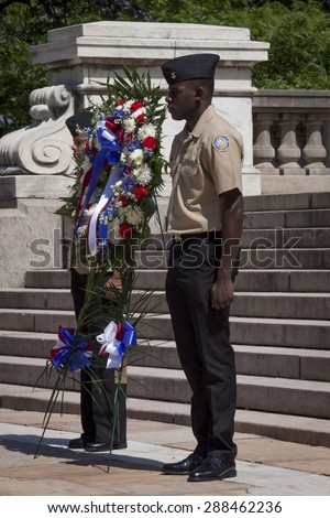NEW YORK - MAY 25 2015: Two members of the Navy JROTC stand at attention next to a floral wreath at the Memorial Day Observance service at the Soldiers and Sailors Monument during Fleet Week NY 2015. - stock photo