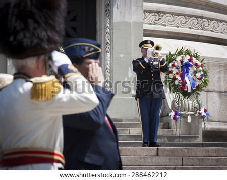 NEW YORK - MAY 25 2015: US Navy personnel is saluted as he plays the trumpet at the conclusion of the Memorial Day Observance service at the Soldiers and Sailors Monument during Fleet Week NY 2015. - stock photo