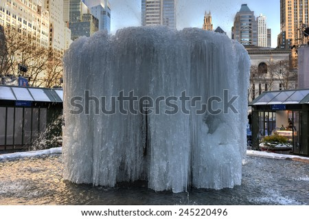 NEW YORK, NEW YORK - JANUARY 10, 2015: Josephine Shaw Lowell Memorial Fountain in Bryant Park, Midtown, Manhattan. It has frozen over during the cold winter. - stock photo