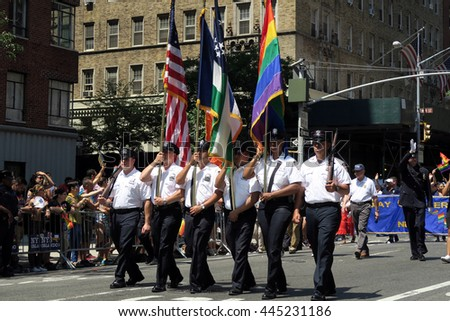 NEW YORK, NEW YORK - JULY 26, 2016: NYPD marching in Gay Pride Parade on 5th avenue. The rainbow flag is the symbol of lesbian, gay, bisexual and transgender pride and diversity. Editorial use only. - stock photo