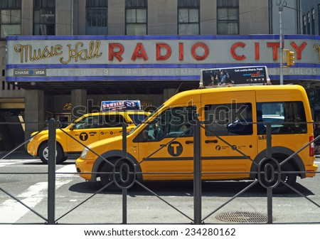 NEW YORK, NEW YORK - June 29, 2014: Radio City Music Hall. Taxis line the street in front of the iconic Radio City Music Hall in New York City.  - stock photo
