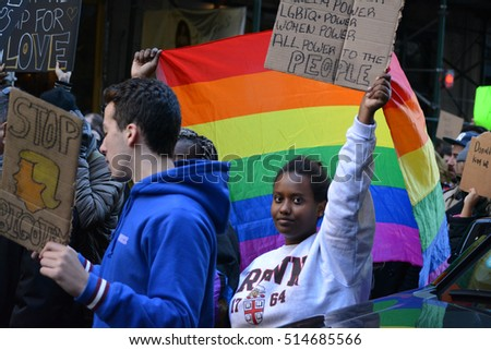 "New York, New York. - November 12, 2016: People carrying signs at a ""Trump is not my President"" rally against President elect Donald Trump in Manhattan in 2016 in New York City."