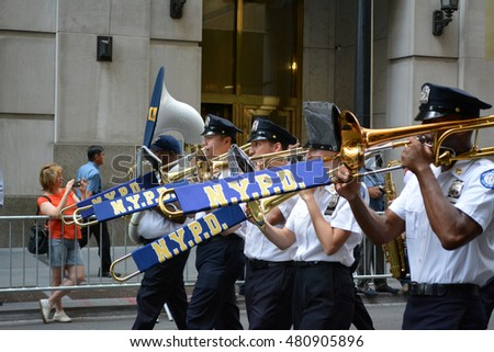 New York, New York. - September 9, 2016: Members of the NYPD band marching in a procession marking the anniversary of the 9/11 terrorist attacks in Lower Manhattan in 2016 in New York City.