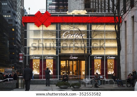 New York, New York, USA - December 11, 2015: A giant red ribbon and bow made of lights can be seen on Cartier on 5th Avenue and 59th Street in New York City during the Christmas Holiday season. - stock photo