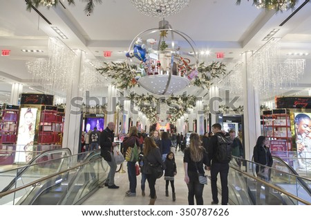 NEW YORK, NEW YORK, USA - DECEMBER 10: Shoppers visit Macy's department store in Herald Square and 34th street.  Taken December 10, 2015 in NY. - stock photo