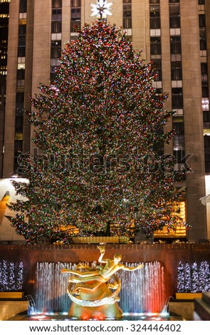 New York, New York, USA - December 2, 2011:The famous Rockefeller Center Christmas Tree and Prometheus Statue at Rockefeller Center. - stock photo
