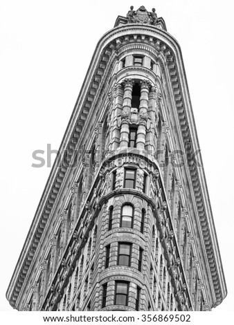 New York, New York, USA - January 4, 2015: Historic Flatiron Building in NYC. This iconic triangular building located in Manhattan's Fifth Ave was completed in 1902. - stock photo