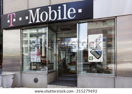 New York, New York, USA - June 2, 2011: A T-Mobile store in downtown Manhattan. There are refelections in the window.