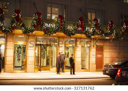 New York, New York, USA - November 28, 2012: Personnel can be seen outside the seasonally decorated entrance of the Omni Berkshire Place Hotel in midtown Manhattan. - stock photo