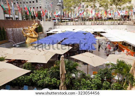 New York, New York, USA - September 13, 2011: Outdoor restaurant and bar at Rockefeller Center at the location where the famous Rockefeller Center Skating Rink is during the holiday season. - stock photo
