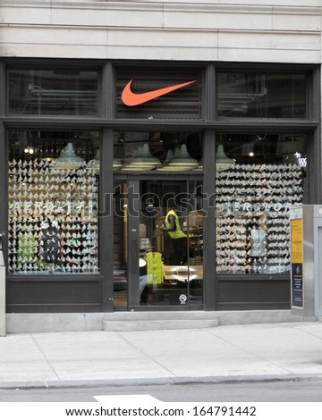 NEW YORK - NOV 27: An exterior view of a Nike retail store in New York City, on November 27, 2013. Many shoppers have been previewing merchandise in preparation for Black Friday shopping.  - stock photo