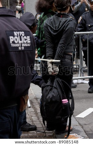NEW YORK - NOV 17:  An unidentified woman arrested at Broad & Beaver Streets on November 17, 2011 in New York City, NY. Dubbed 'Day of Disruption', it is the 2 month mark since the movement began.