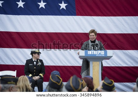NEW YORK - NOV 25 2015: Army vet Loree Sutton, Commissioner of NYC Mayors Office of Veterans Affairs speaks at the ceremony on the USS Intrepid Sea, Air & Space Museum at Pier 86 on Veterans Day. - stock photo