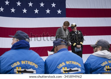 NEW YORK - NOV 25 2015: Army vet Loree Sutton Commissioner of NYC Office of Veterans Affairs and Rear Admiral Cynthia M. Thebaud on stage for the ceremony on the Intrepid on Veterans Day. - stock photo