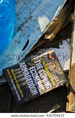 NEW YORK -NOV 12:Book on the ground after Hurricane Sandy in the flooded neighborhood at South Beach Staten Island area on November 10, 2012 in New York City, NY.  - stock photo