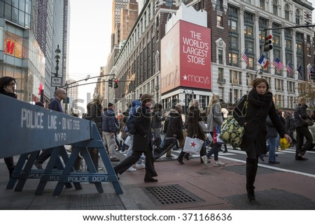 NEW YORK - NOV 25 2015: Crowds of people walk past the historic Macy's department store at 34th St and 6th Ave the day before Thanksgiving and the 89th Annual Thanksgiving Day Parade in Manhattan. - stock photo