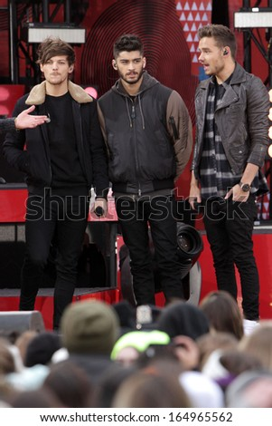 NEW YORK - NOV 26: Louis Tomlinson, Zayn Malik and Liam Payne of One Direction perform on 'Good Morning America' in Central Park on November 26, 2013 in New York City. - stock photo