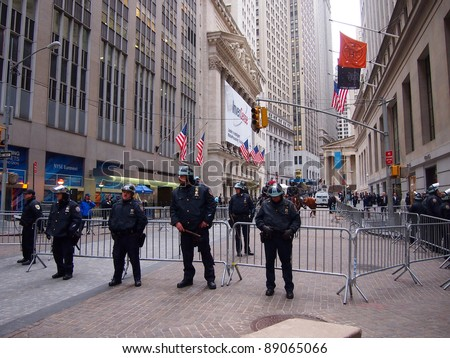 NEW YORK - NOV 17: Police guard the New York Stock Exchange, Lower Manhattan, on November 17, 2011 in New York City. Security was high as a result of Occupy Wall Street protests. - stock photo