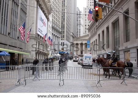 NEW YORK - NOV 17: Police temporarily clear the area at Broad Street and Exchange Place near the entrance to the NY Stock Exchange on the 'Day of Disruption' on November 17, 2011 in New York City, NY. - stock photo