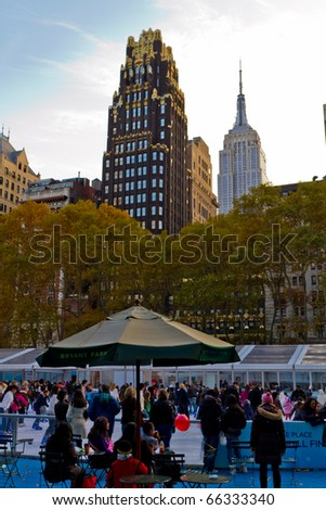 NEW YORK - NOV 27 : The famous annual Christmas market take place in Bryant Park under the skyscrapers, people enjoy the ice skating rink and buy Christmas gifts, on November 27, 2010 in New York. - stock photo