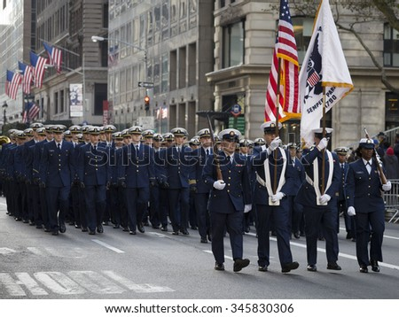 NEW YORK - NOV 25 2015: U.S. Coast guard personnel march in uniform lines during the annual Americas Parade up 5th Avenue on Veterans Day in Manhattan. - stock photo