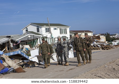 NEW YORK -NOV 12: US Army helping Hurricane Sandy victims move a debris and parts of destroyed houses in the Breezy Point on November 12, 2012 in the Queens,  NY