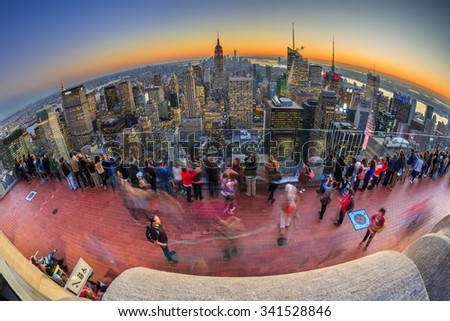 NEW YORK - NOV 05: Visitors enjoy aerial view  of New York City at twilight on Nov 05, 2015. New York City is the most densely populated city in the United States. - stock photo