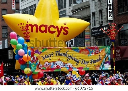 NEW YORK - NOVEMBER 25: A banner appears in the 84th Macy's Thanksgiving Day Parade on November 25, 2010 in New York City. - stock photo