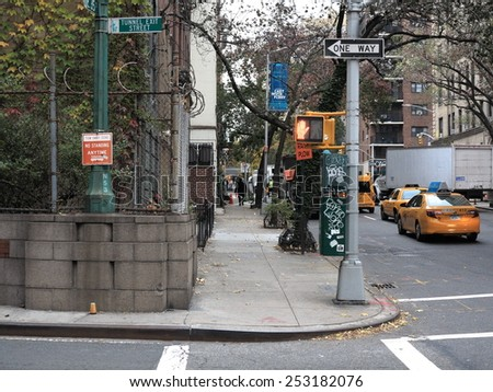 NEW YORK - NOVEMBER 13:  A downtown Manhattan sidewalk on November 13, 2014 in New York. Manhattan's street grid was designed in 1811. - stock photo